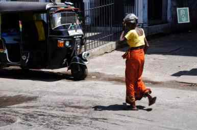 Woman is strolling down the street in Colombo, Sri Lanka