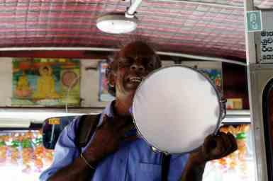 Man's playing a tambourine