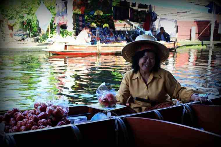 Thai woman smiling, Floating Market in Thailand