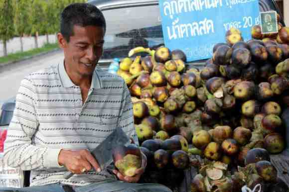 Locals selling tropical fruits