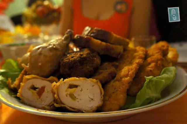 A plate of pork chops and meatballs
