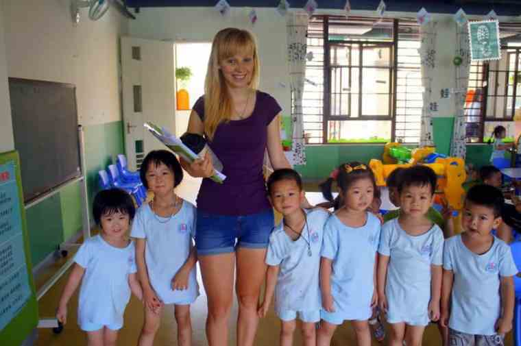 A young teacher with Chinese students