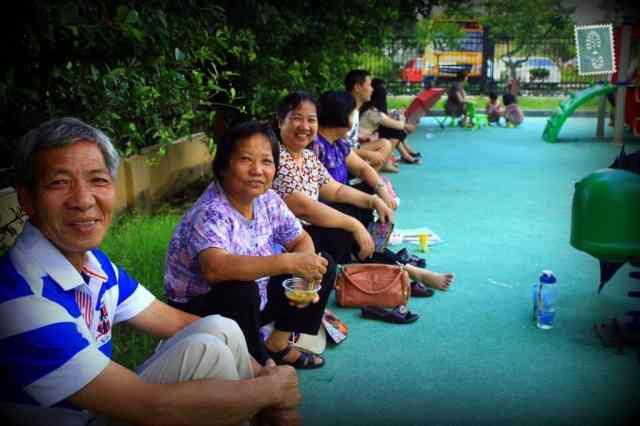Chinese sitting on a pavement