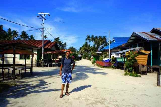 A boy is walking in Derawan