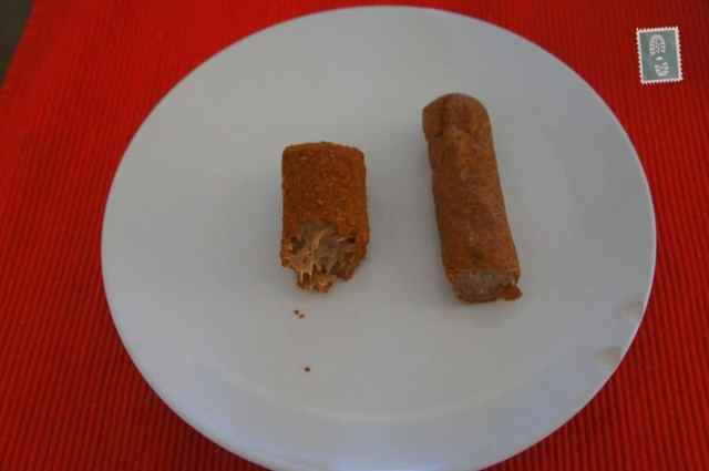 dutch frikadel and kroket on a table