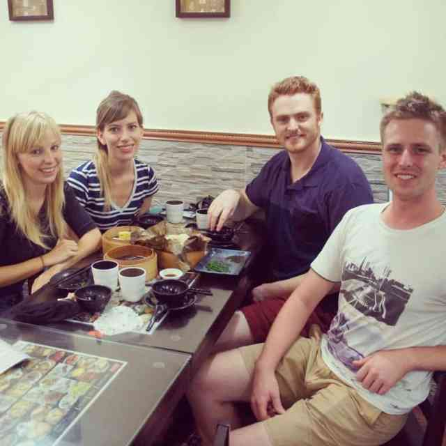 four people are eating dim sum in Hong Kong