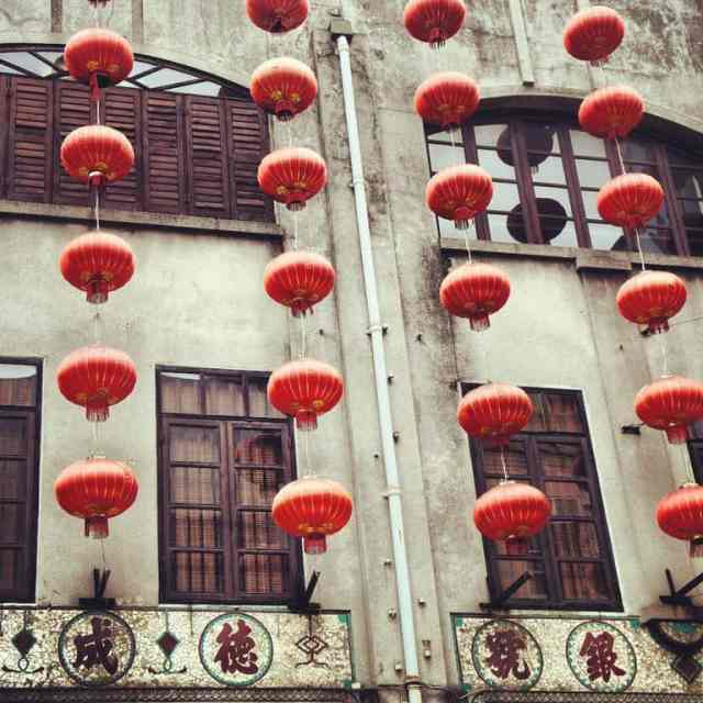 Chinese lanterns hanging on Macau buildings.