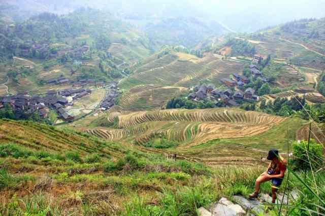 A girl is hiking The stunning Longsheng Rice Terraces