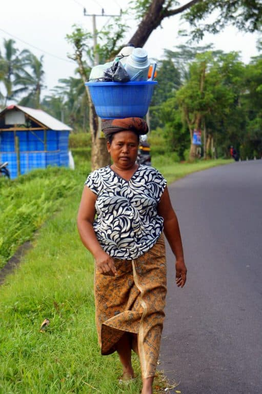 Indonesian woman carrying a basket