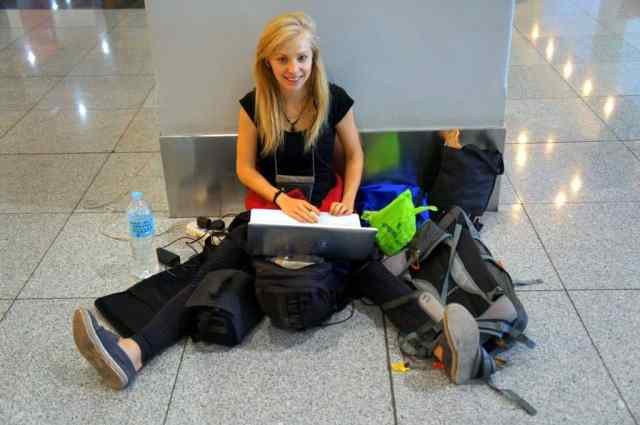 A girl blogging at the airport