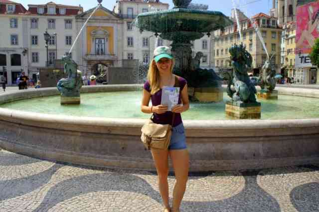 a girl with a map in Lisbon