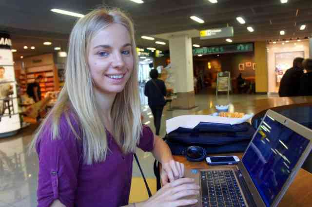 A girl is blogging at the airport