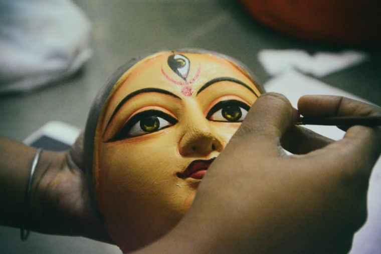 Man paining a mask