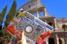 Laptop and the Colosseum