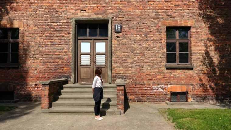 Lydia reflects outside block 16