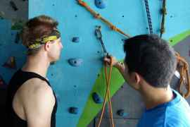 Learning how to correctly clip in while lead climbing