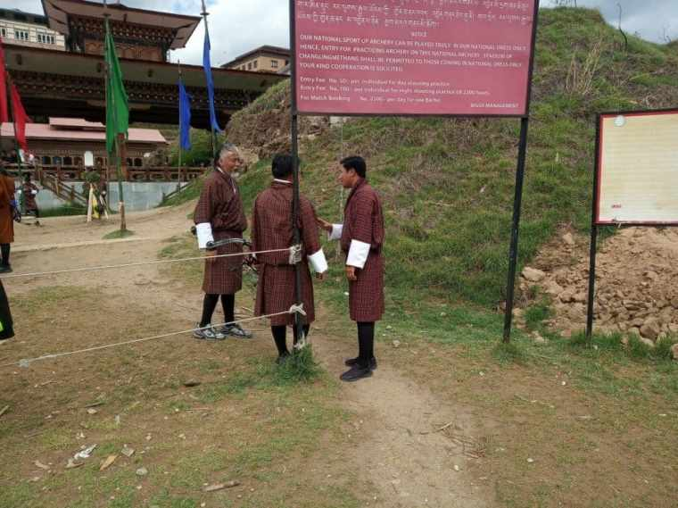 Three Bhutanese men in conversation