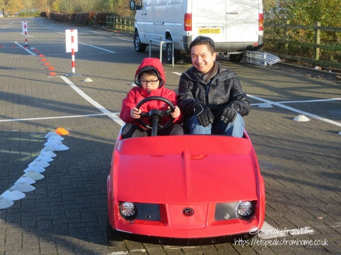 Young Driver Electric Firefly with parent