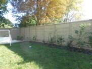 Aménagement clôture béton décorative imitation pierre Vineuil