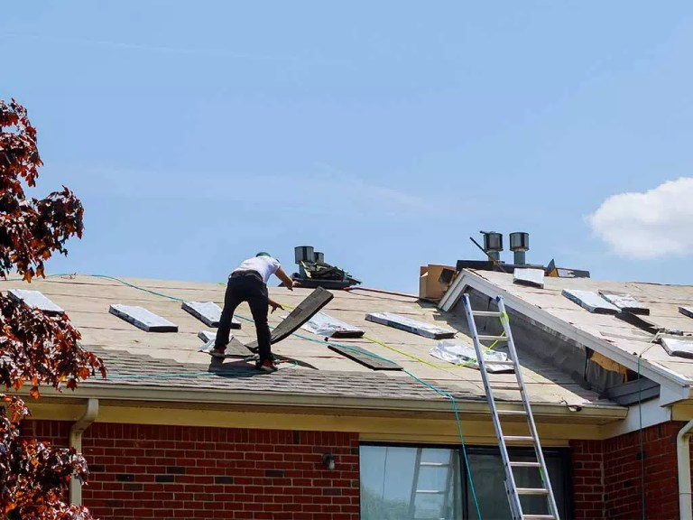 Home roof construction applying roof new shingles in apartment building