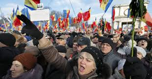 Flag-waving demonstrators protest against against the government in Moldovan capital, Chisinau