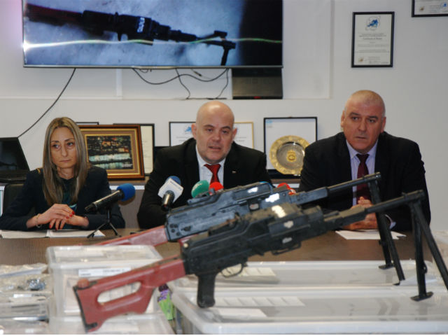 Prosecutor Evgenia Stankova (left), Deputy Prosecutor General Ivan Geshev (center) and Organized Crime unit director Ivaylo Spiridonov gave a press conference behind stacked weapons on Wednesday.