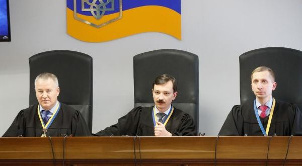 Three judges of Obolon District Court announce a sentence for former Ukrainian president Viktor Yanukovych, in Kiev, Ukraine, on Thursday. Photograph: Sergey Dolzhenko