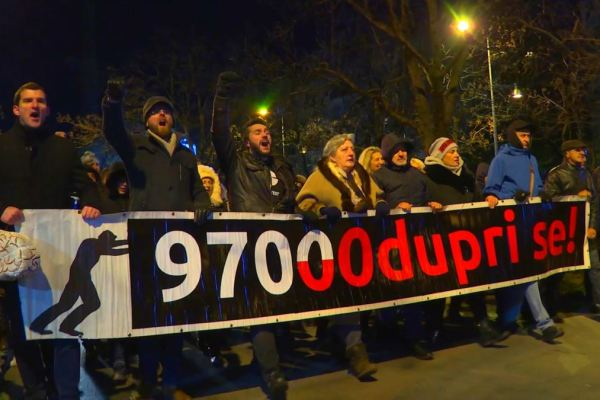 Protesters march in Montenegro demanding the resignation of President Milo Djukanovic