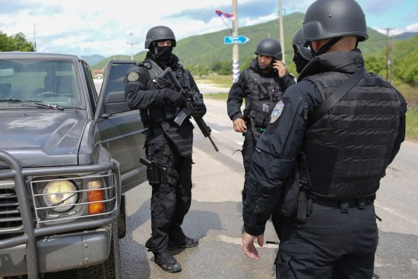 Kosovo police special unit members secure the area near the village of Cabra in northwestern Kosovo during an ongoing police operation on Tuesday, May 28