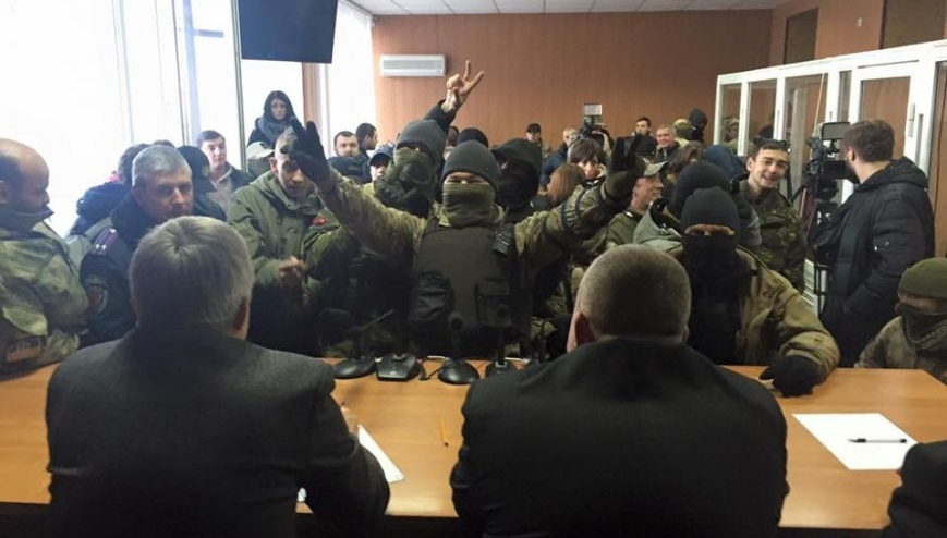 Photo made by Ukrainian media: Neo-Nazis force judges to resign. November 30, 2015