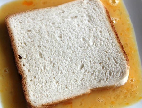 Dip the bread slice into the mixture.