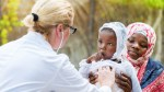 Picture of the doctor examining an African child