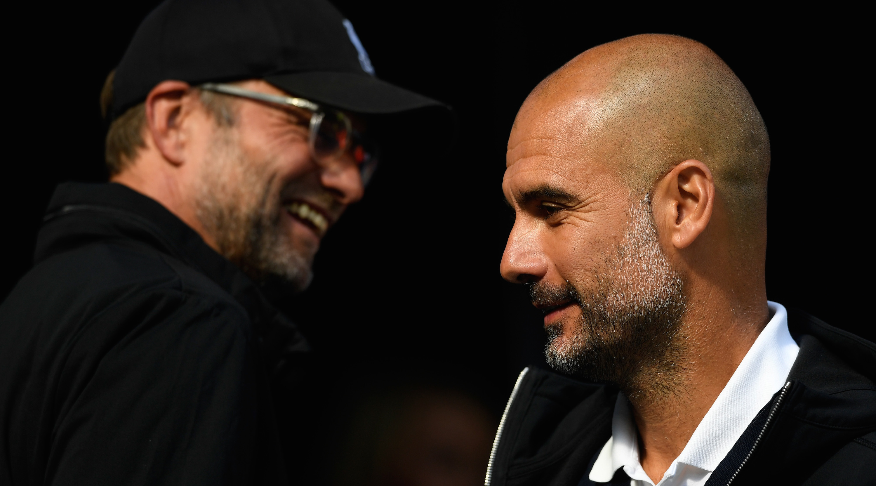 Jurgen Klopp, Manager of Liverpool smiles as Josep Guardiola, Manager of Manchester City looks on prior to the Premier League match between Manchester City and Liverpool at Etihad Stadium on September 9, 2017 in Manchester, England. (Photo by Stu Forster/Getty Images)