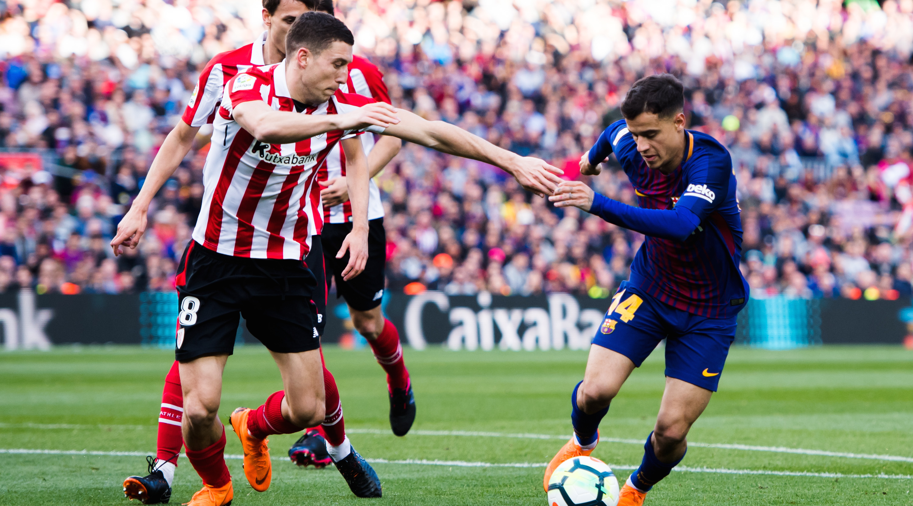 BARCELONA, SPAIN - MARCH 18: Philippe Coutinho of FC Barcelona dribbles Oscar De Marcos of Athletic Club during the La Liga match between Barcelona and Athletic Club at Camp Nou on March 18, 2018 in Barcelona, Spain. (Photo by Alex Caparros/Getty Images)
