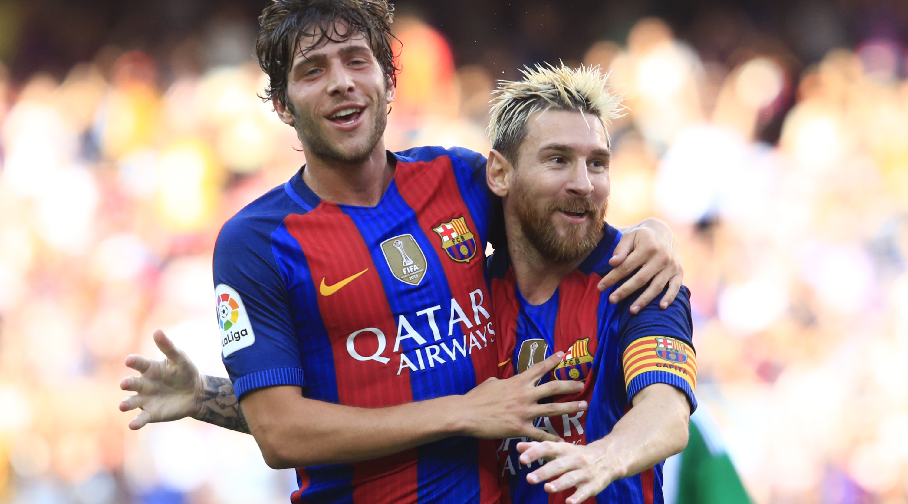 Barcelona's Argentinian forward Lionel Messi (R) celebrates after scoring with Barcelona's midfielder Sergi Roberto during the Spanish league football match FC Barcelona vs Real Betis Balompie at the Camp Nou stadium in Barcelona on August 20, 2016. / AFP / PAU BARRENA (Photo credit should read PAU BARRENA/AFP/Getty Images)