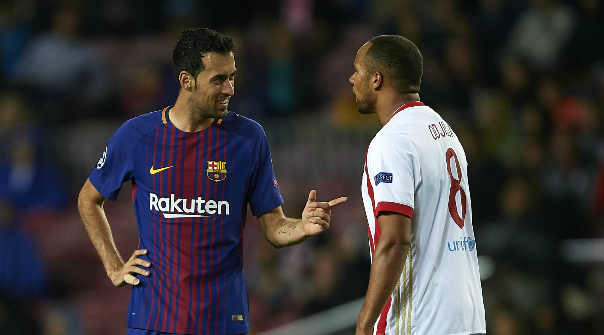 BARCELONA, SPAIN - OCTOBER 18: Sergio Busquets of Barcelona argues with Vadis Odjidja of Olympiakos Piraeus during the UEFA Champions League group D match between FC Barcelona and Olympiakos Piraeus at Camp Nou on October 18, 2017 in Barcelona, Spain. (Photo by Manuel Queimadelos Alonso/Getty Images)
