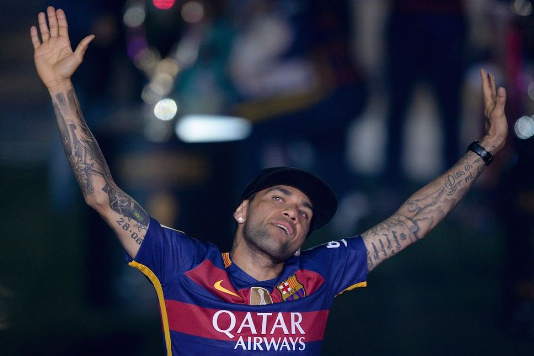 """Barcelona's Brazilian defender Dani Alves acknowledges the crowd during celebrations at the Camp Nou stadium in Barcelona on May 23, 2016 following their Spanish """"Copa del Rey"""" (King's Cup) final football match 2-0 victory over Sevilla FC yesterday also marking the club's 28th Copa del Rey win and the 24th Spanish Liga title. / AFP / JOSEP LAGO (Photo credit should read JOSEP LAGO/AFP/Getty Images)"""