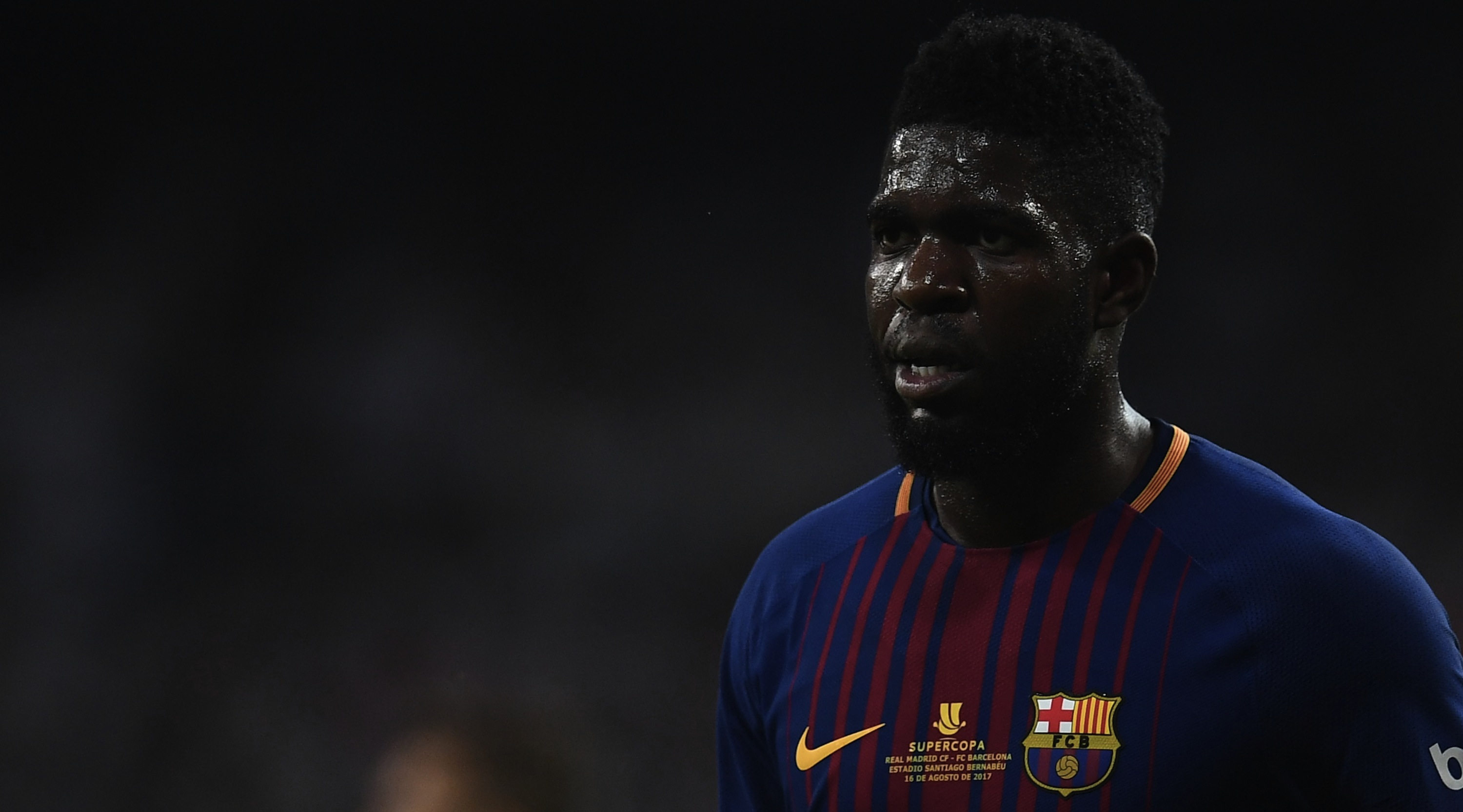 Barcelona's French defender Samuel Umtiti looks on during the second leg of the Spanish Supercup football match Real Madrid vs FC Barcelona at the Santiago Bernabeu stadium in Madrid, on August 16, 2017. / AFP PHOTO / GABRIEL BOUYS (Photo credit should read GABRIEL BOUYS/AFP/Getty Images)