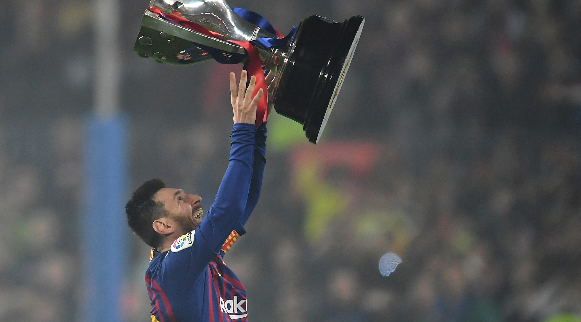 Lionel Messi of FC Barcelona celebrates with the La Liga trophy following his team's victory in the La Liga match between FC Barcelona and Levante UD at Camp Nou on April 27, 2019 in Barcelona, Spain. (Photo by David Ramos/Getty Images)