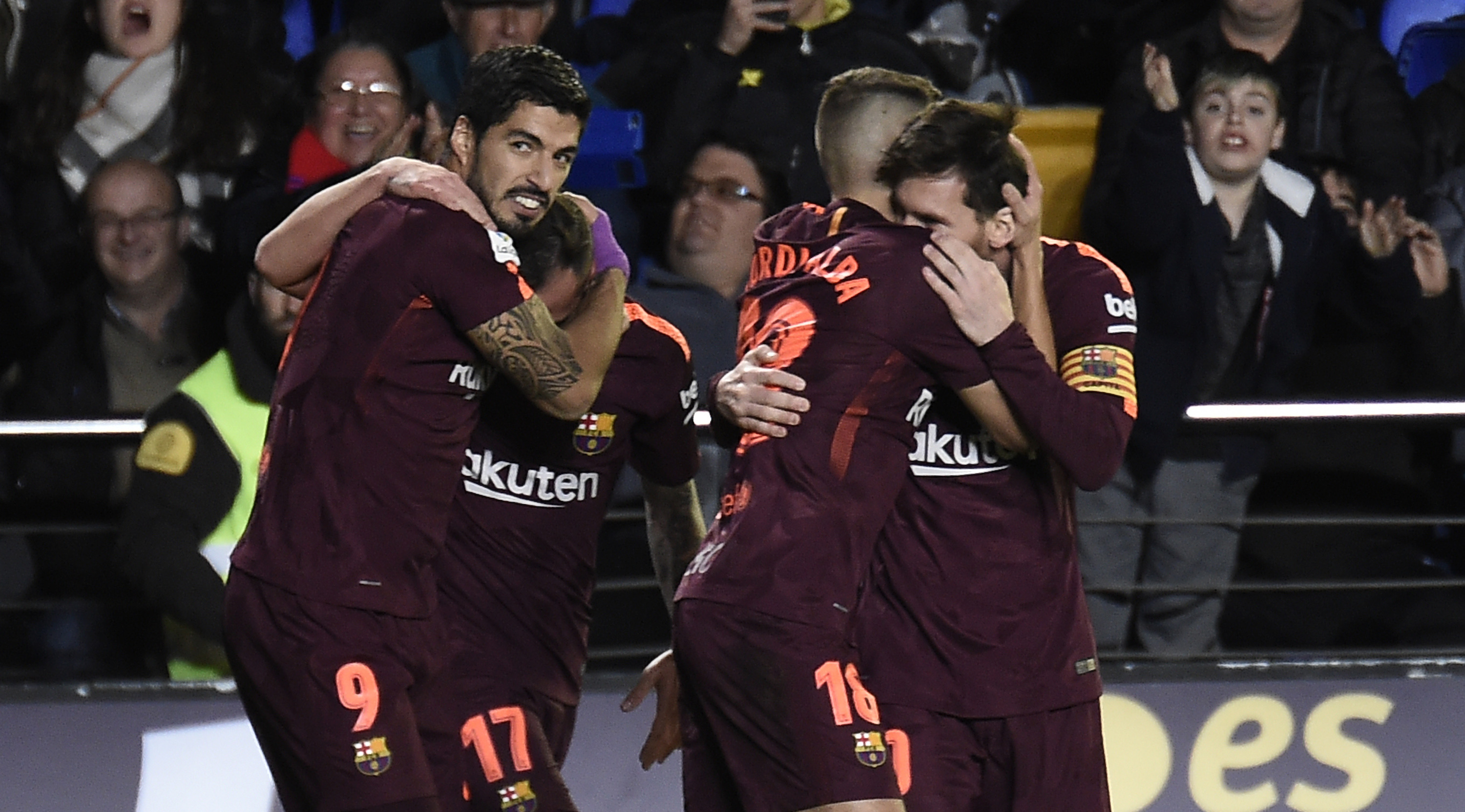 Barcelona's Uruguayan forward Luis Suarez (L) celebrates with teammates after scoring during the Spanish league football match between Villarreal CF and FC Barcelona at La Ceramica stadium in Vila-real on December 10, 2017. / AFP PHOTO / JOSE JORDAN (Photo credit should read JOSE JORDAN/AFP/Getty Images)