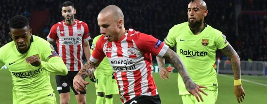 PSV Eindhoven's Angelino (R) vies with Barcelona's Portuguese defender Nelson Semedo (L) during the UEFA Champions League football match between PSV Eindhoven and FC Barcelona at Philips stadium in Eindhoven on November 28, 2018. (Photo by EMMANUEL DUNAND / AFP) (Photo credit should read EMMANUEL DUNAND/AFP/Getty Images)