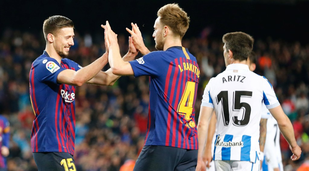 Barcelona's French defender Clement Lenglet (L) celebrates his goal with Barcelona's Croatian midfielder Ivan Rakitic during the Spanish league football match between FC Barcelona and Real Sociedad at the Camp Nou stadium in Barcelona on April 20, 2019. (Photo by PAU BARRENA / AFP) (Photo credit should read PAU BARRENA/AFP/Getty Images)