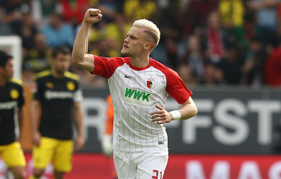 AUGSBURG, GERMANY - SEPTEMBER 30: Philipp Max of Augsburg celebrates after Caiuby of Augsburg (not pictured) scored the first goal for Augsburg to make it 1:1 during the Bundesliga match between FC Augsburg and Borussia Dortmund at WWK-Arena on September 30, 2017 in Augsburg, Germany. (Photo by Adam Pretty/Bongarts/Getty Images)