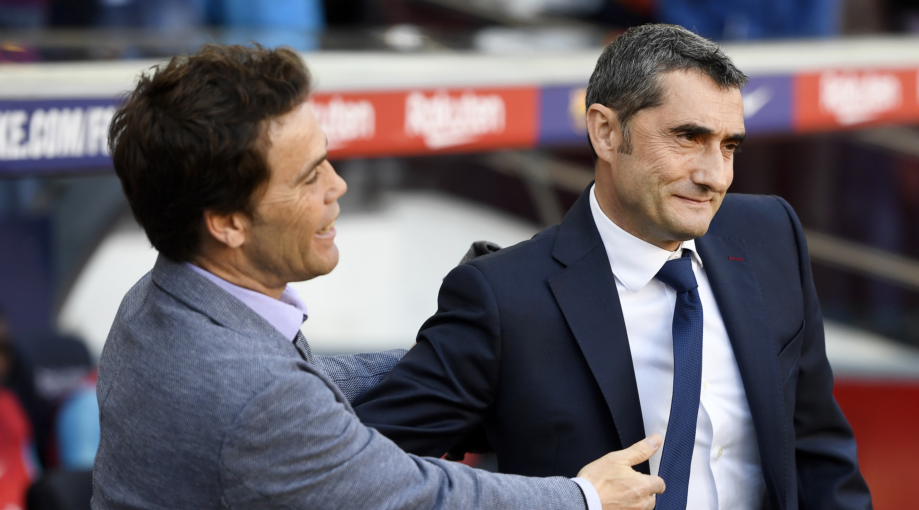 Joan Sicilia, Manager of of RCD Espanyol is greeted by Ernesto Valverde, Manager of Barcelona prior to the La Liga match between FC Barcelona and RCD Espanyol at Camp Nou on March 30, 2019 in Barcelona, Spain. (Photo by Alex Caparros/Getty Images)