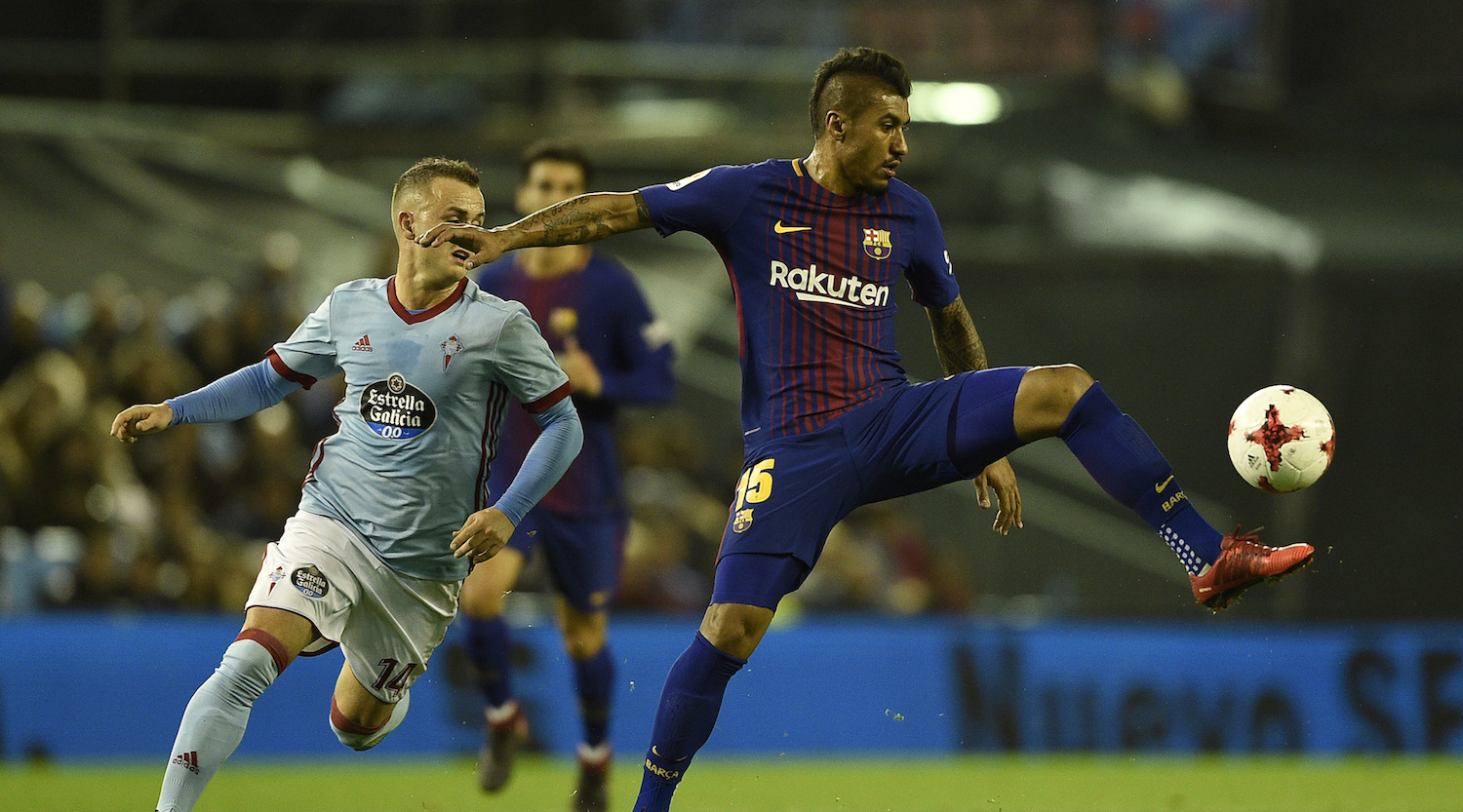 VIGO, SPAIN - JANUARY 04: Stanislav Lobotka of RC Celta de Vigo competes for the ball with Paulinho of FC Barcelona during the Copa del Rey round of 16 first leg match between RC Celta de Vigo and FC Barcelona at Municipal Balaidos on January 4, 2018 in Vigo, Spain. (Photo by Octavio Passos/Getty Images)