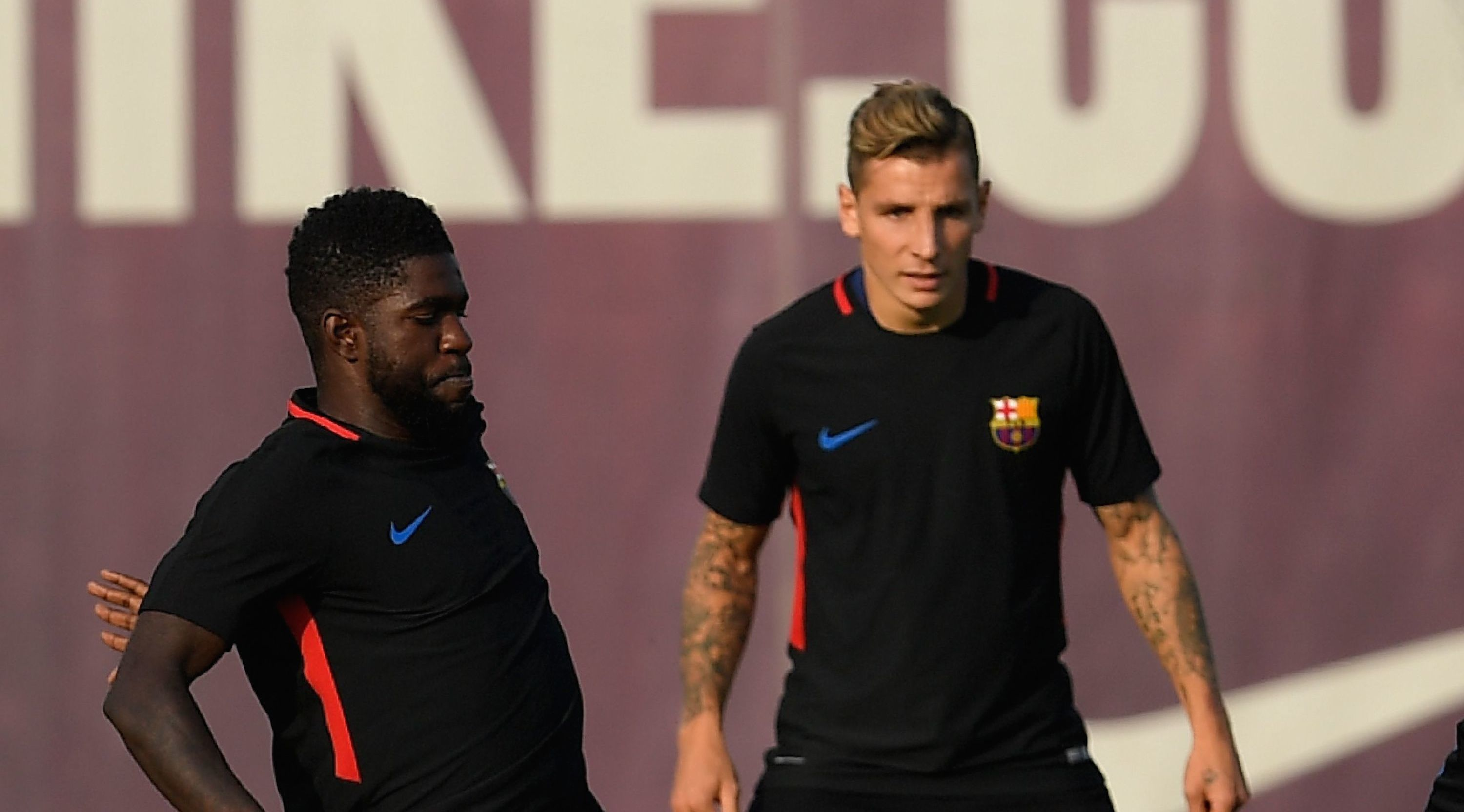 (FromL) Barcelona's French defender Samuel Umtiti, Barcelona's French defender Lucas Digne, Barcelona's french forward Ousmane Dembele and Barcelona's Argentinian forward Lionel Messi play with a ball during a training session at the Sports Center FC Barcelona Joan Gamper in Sant Joan Despi, near Barcelona on September 8, 2017, on the eve of the Spanish League match FC Barcelona vs RCD Espanyol. / AFP PHOTO / LLUIS GENE (Photo credit should read LLUIS GENE/AFP/Getty Images)