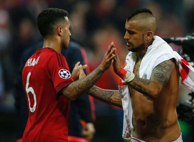 Bayern Munich's Chilean midfielder Arturo Vidal (R) and Bayern Munich's Spanish midfielder Thiago Alcantara celebrate after the Champions League quarter-final, first-leg football match between Bayern Munich and Benfica Lisbon in Munich, southern Germany, on April 5, 2016.
