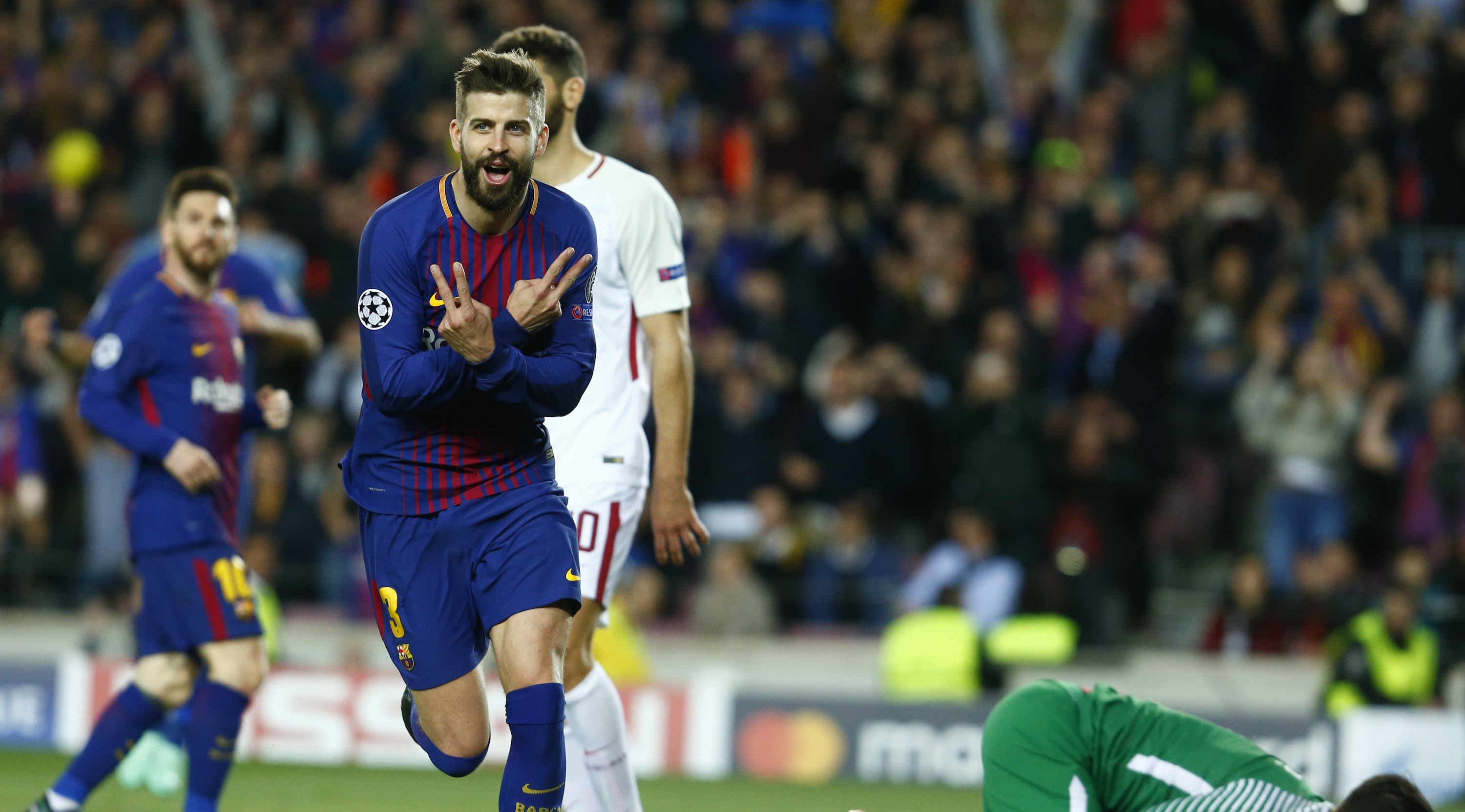 Barcelona's Spanish defender Gerard Pique celebrates a goal during the UEFA Champions League quarter-final first leg football match between FC Barcelona and AS Roma at the Camp Nou Stadium in Barcelona on April 4, 2018. / AFP PHOTO / Pau Barrena (Photo credit should read PAU BARRENA/AFP/Getty Images)