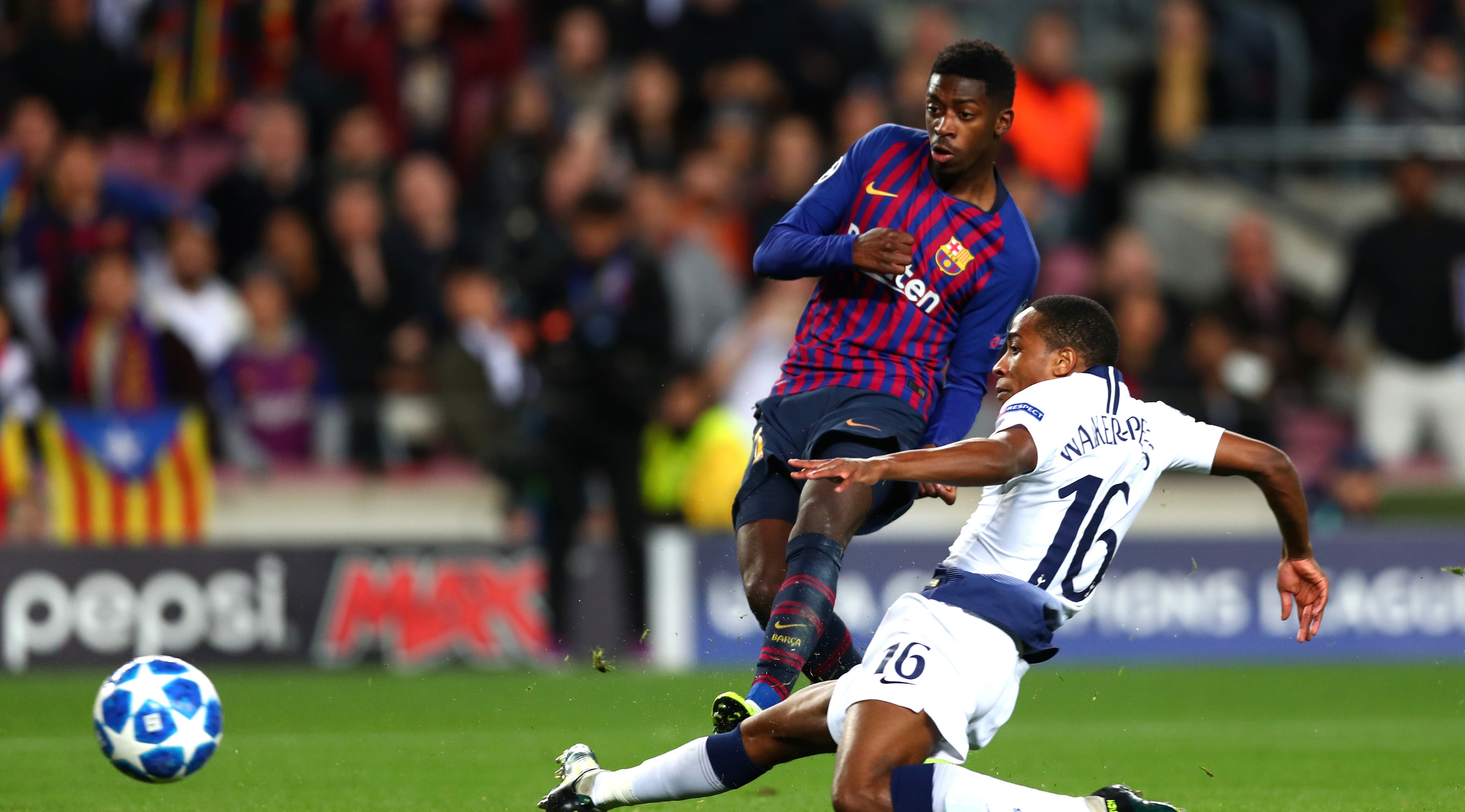 Ousmane Dembele of Barcelona (11) scores his team's first goal as Kyle Walkers-Peters of Tottenham Hotspur challenges during the UEFA Champions League Group B match between FC Barcelona and Tottenham Hotspur at Camp Nou on December 11, 2018 in Barcelona, Spain. (Photo by Clive Rose/Getty Images)