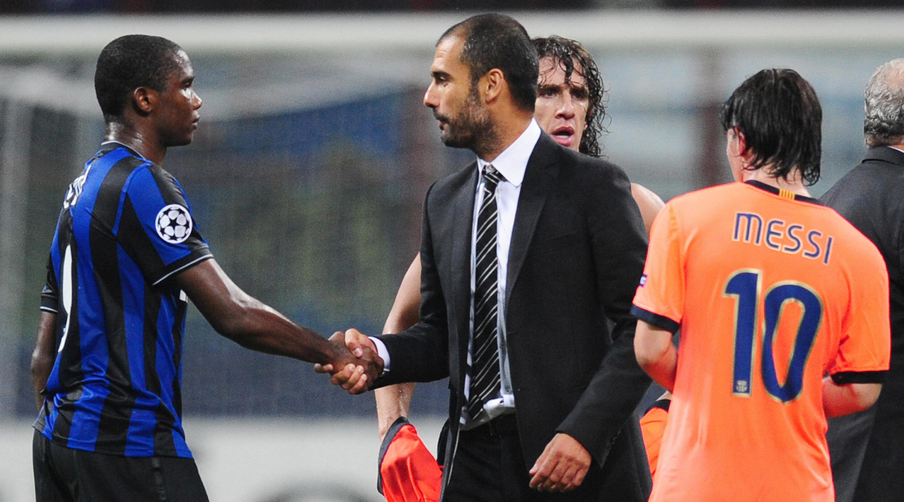 Barcelona's Josep Guardiola (C) shakes hands with Inter Milan's Cameroonian forward Samuel Eto'o next to Barcelona's Argentinian forward Lionel Messi (R) and Barcelona's captain Carles Puyol (2D-R) after their UEFA Champions League football match at San Siro Stadium in Milan on September 16, 2009. The match ended in a 0-0 draw. AFP PHOTO / Christophe Simon (Photo credit should read CHRISTOPHE SIMON/AFP/Getty Images)